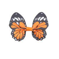 Schmetterling 65x50mm - Ripsband Orange Schwarz Weiß